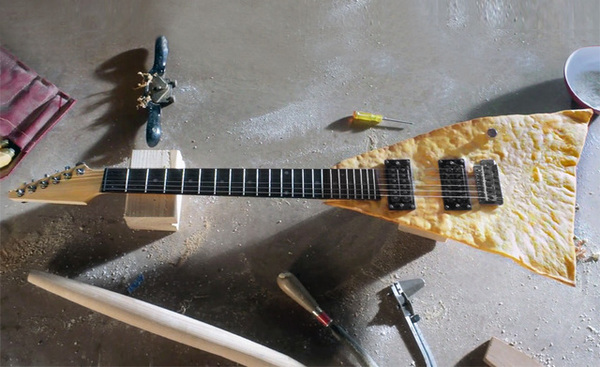 Thumb tortilla chip guitar